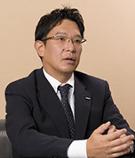小野 賢次 氏